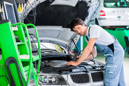 BMP Autoservice technician working on a BMW engine issue